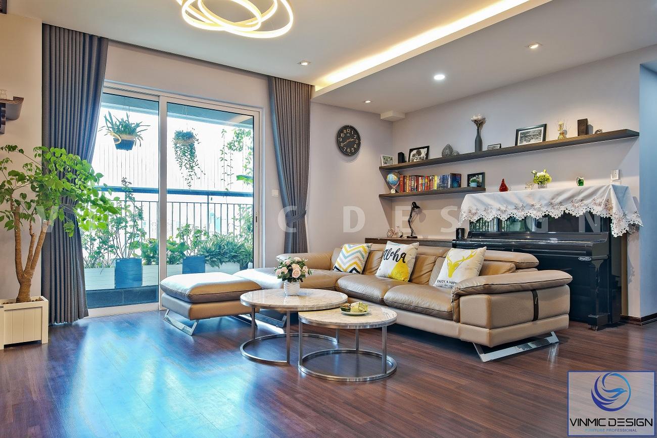 Thi công phòng khách với bộ sofa ấn tượng và các đồ trang trí