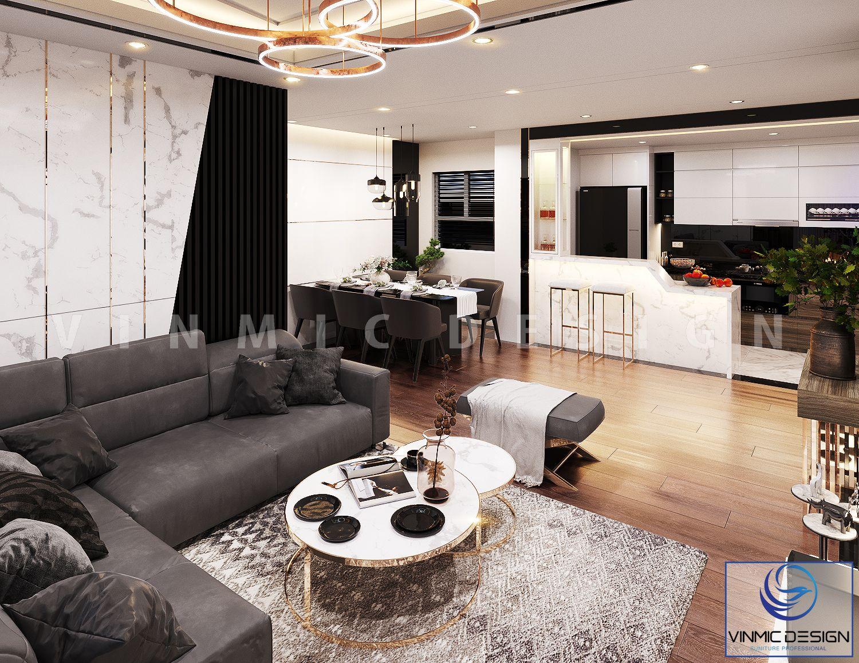 Màu sắc của đèn và bộ sofa làm nổi bật phòng khách