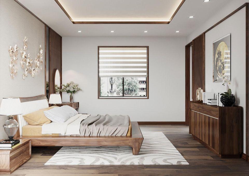 Giường ngủ cũng được thiết kế rất tỉ mĩ, để tôn lên chất gỗ óc chó tự nhiên