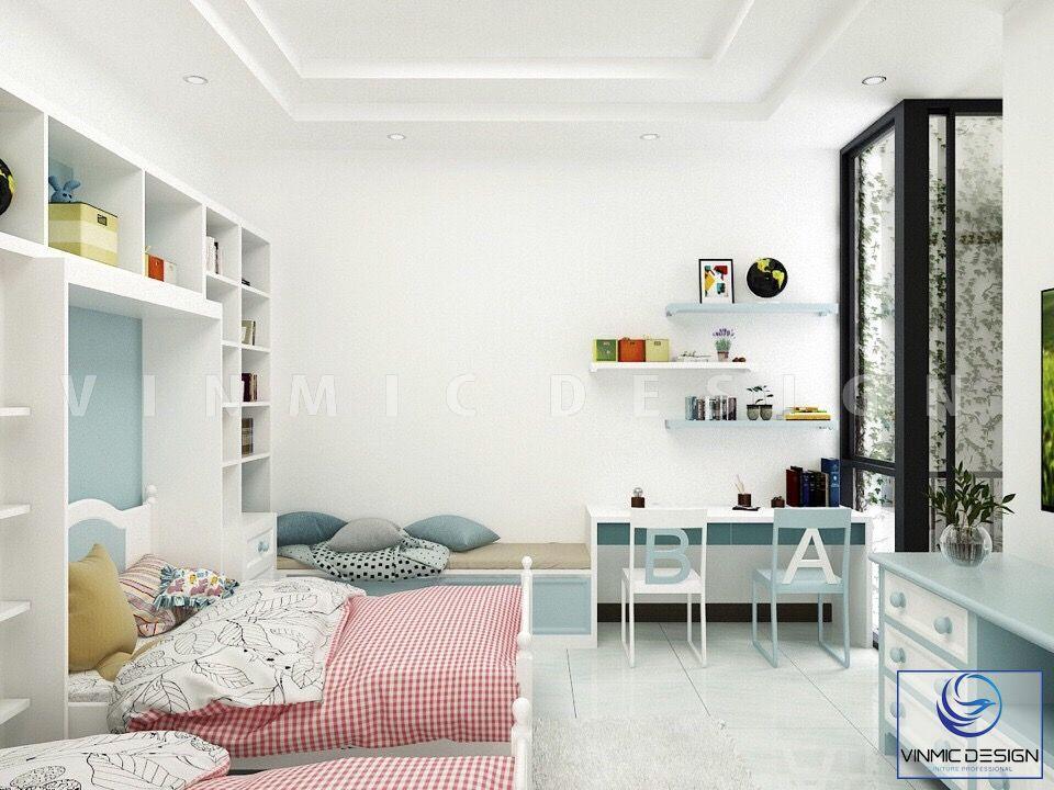 Ở góc khác, phòng ngủ của 2 bé sinh đôi có không gian học tập thoáng mát ngay cạnh cửa