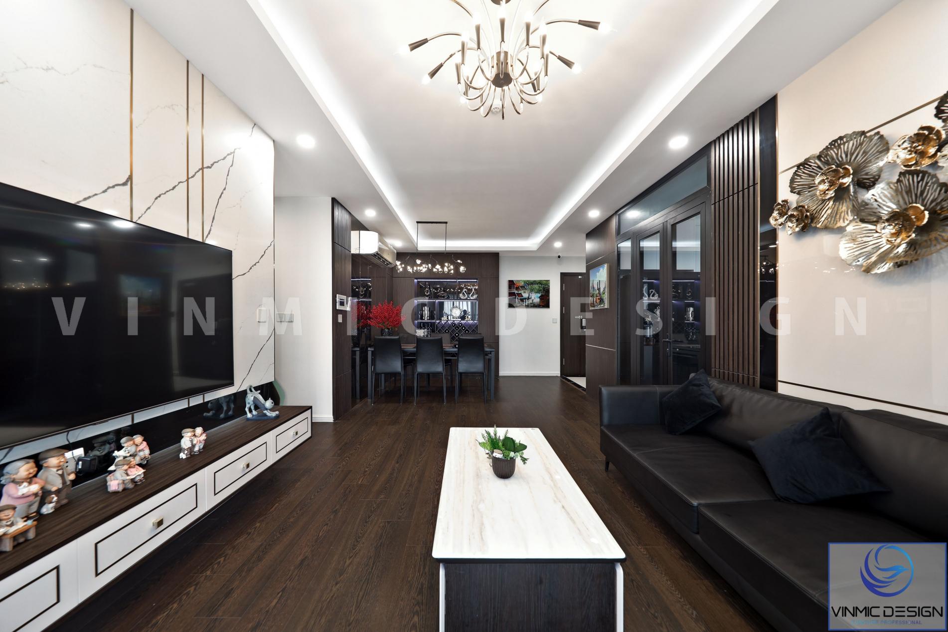 Thi công nội thất phòng khách với bàn trà đẹp và kệ tivi đẹp tại chung cư Imperia Sky Garden