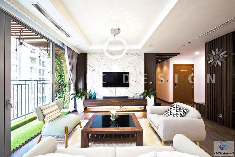 Phòng khách nổi bật với cách phối đá ốp tường và ốp vách gỗ tương phản nhưng hài hòa