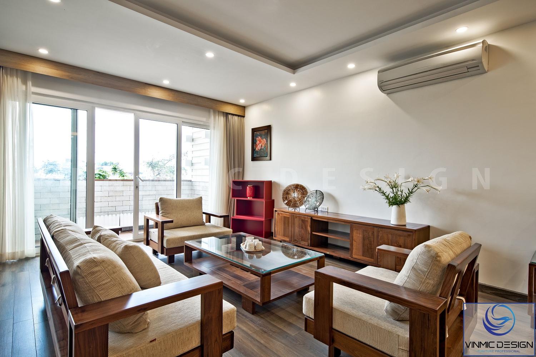 Sofa gỗ sồi chắc chắn kết hợp sàn gỗ tạo thể thống nhất.