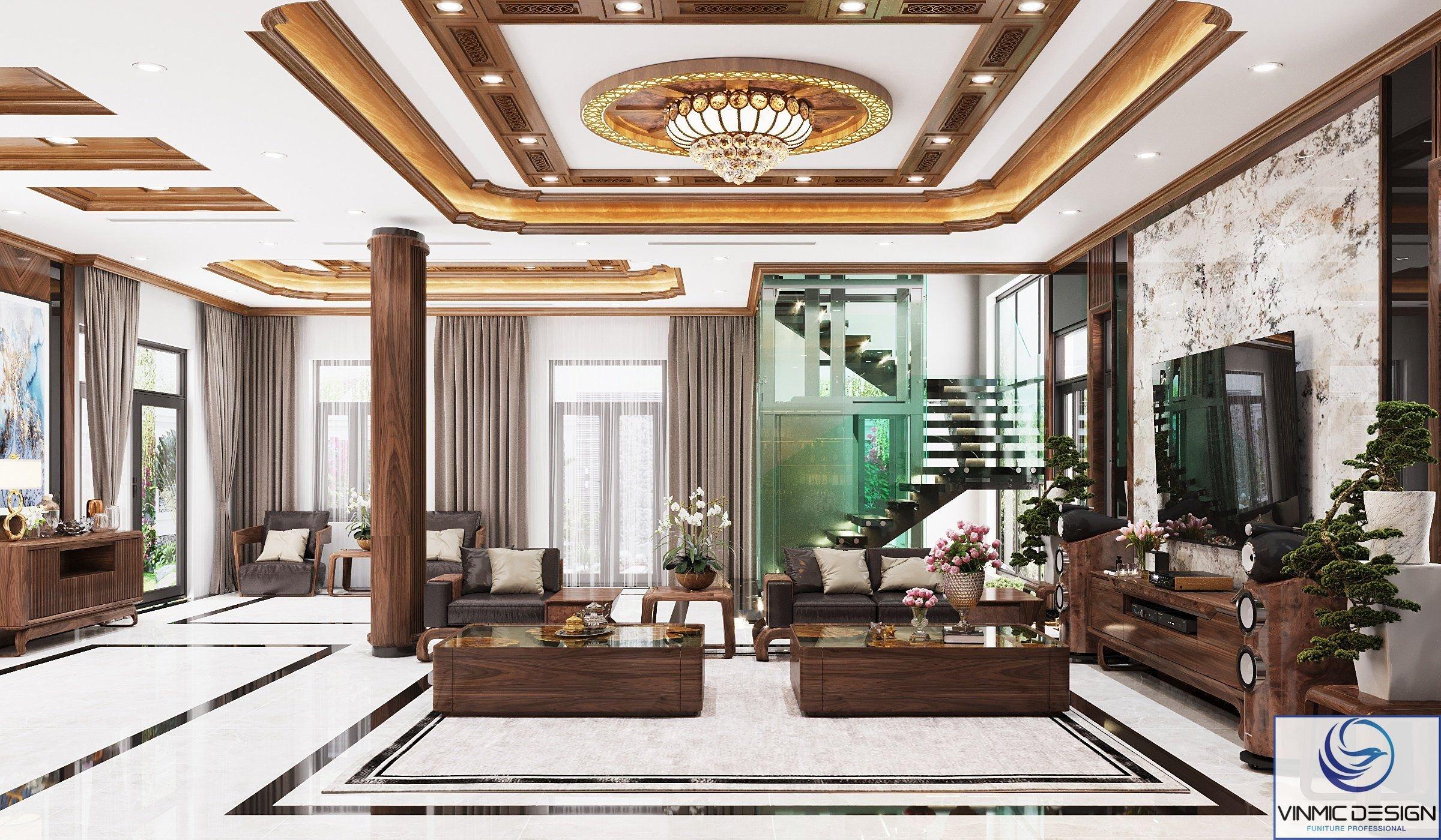 Không gian phòng khách được trang trí với những đồ gỗ óc chó sang trọng và đường nét tỉ mỉ