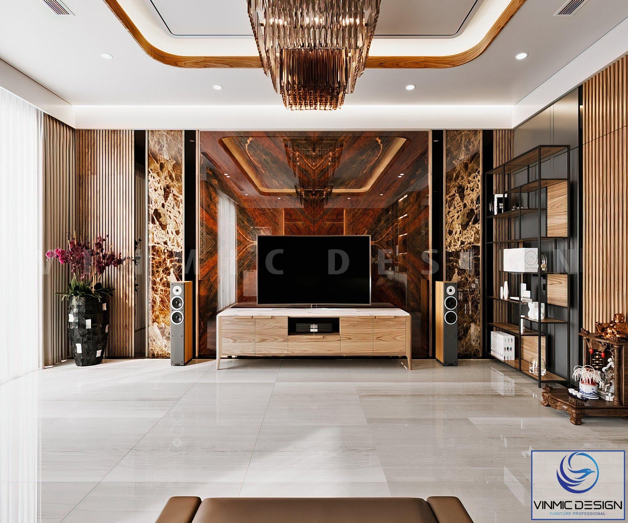 Đối điện vách sau sofa là vách tivi cũng bằng chất liên đá tự nhiên tạo nên sự đồng nhất.
