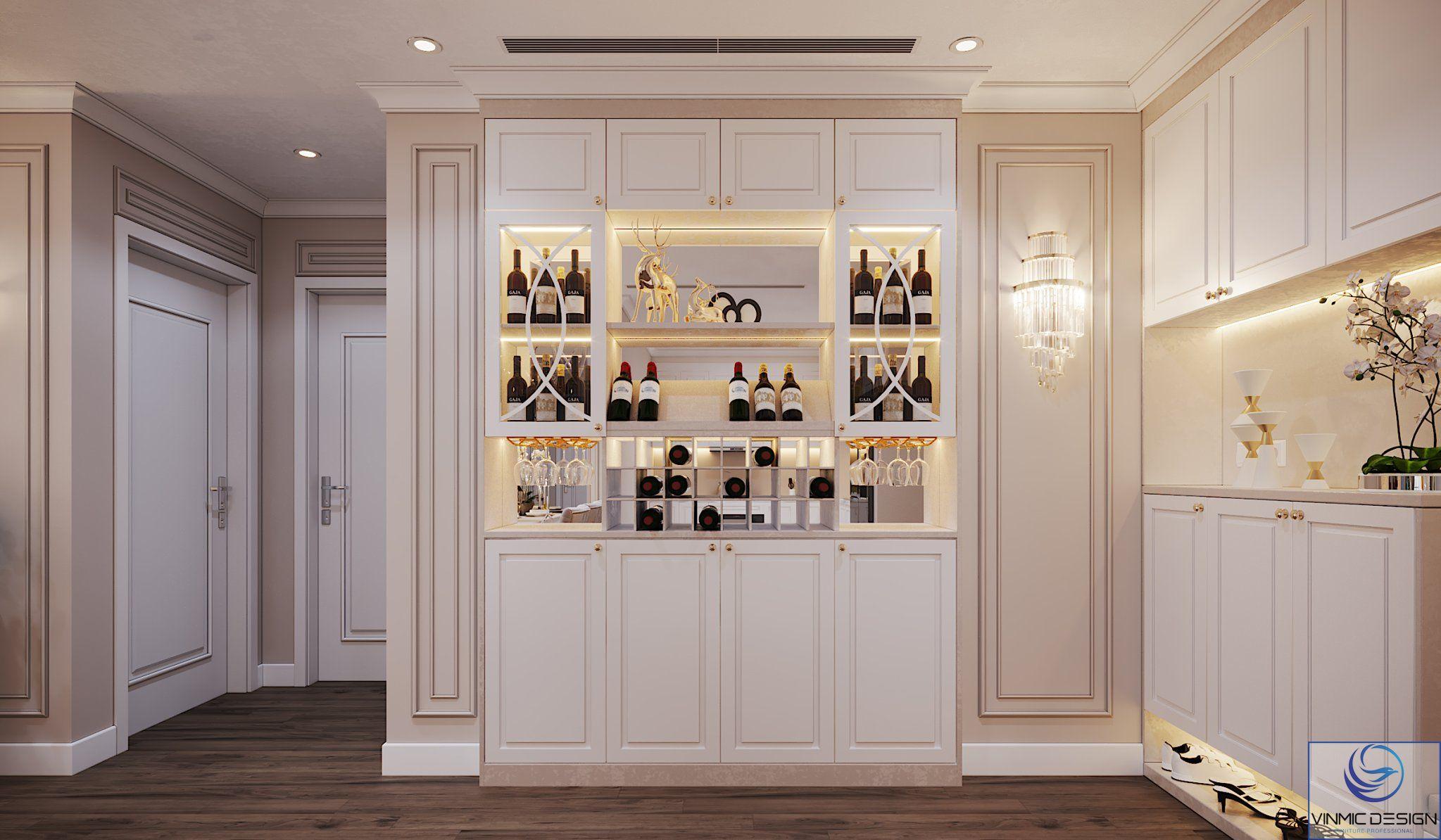 Tủ đồ kết hợp tủ rượu với những đường chỉ, phào đặc trưng của phong cách tân cổ điển.